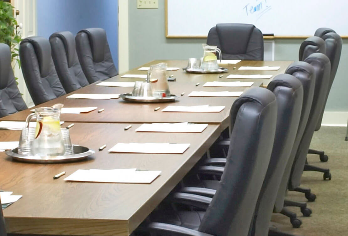 Meeting room table with chairs