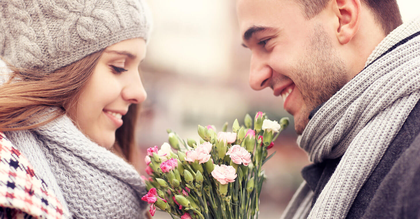 Romantic couple in the winter with flowers