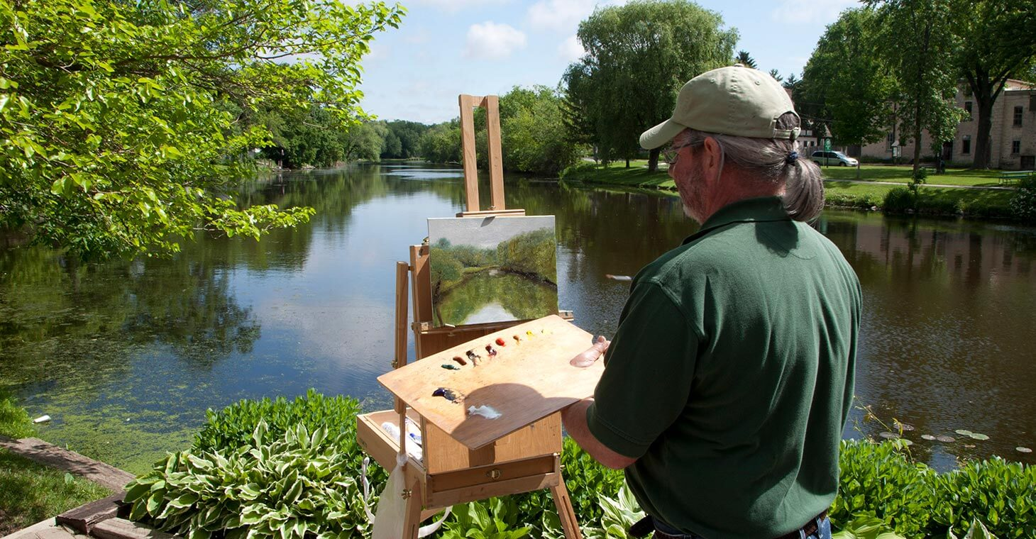 Painter painting the creek