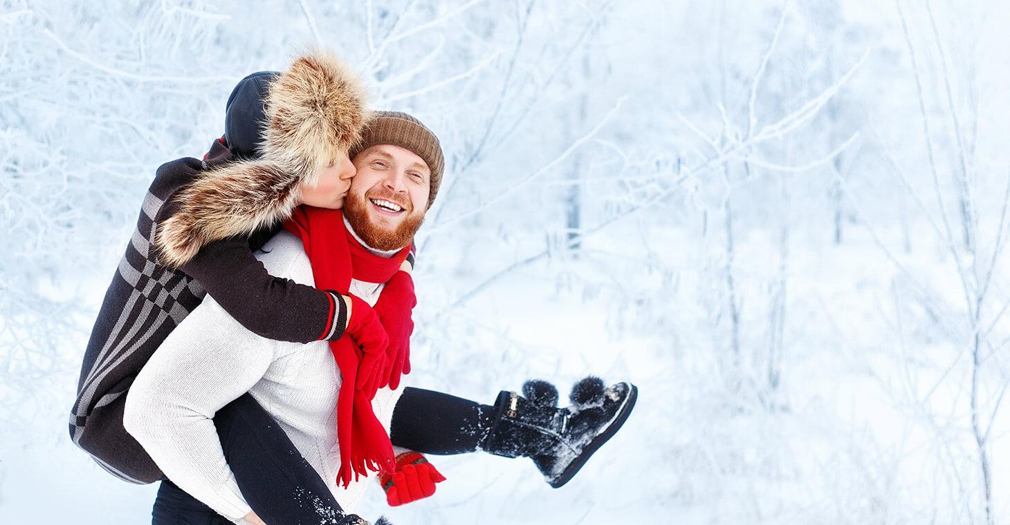 Happy couple having fun in the snow