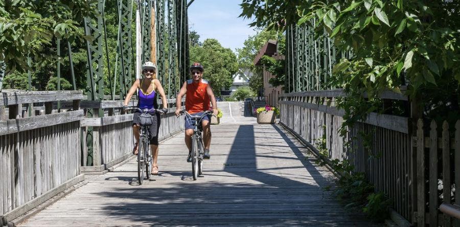 Couple biking on the Ozaukee Interurban Trail in Wisconsin
