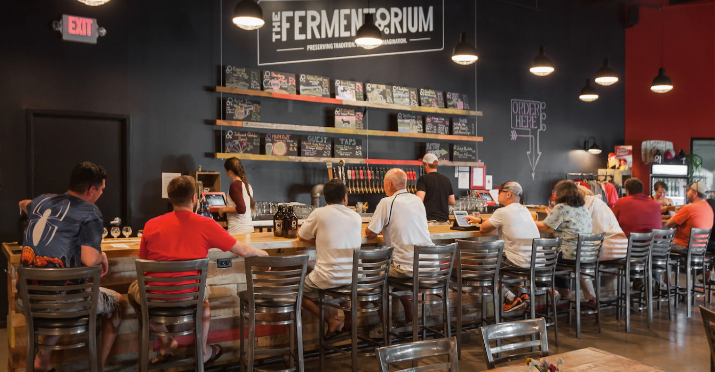 the Fermentorium with people seated at the bar