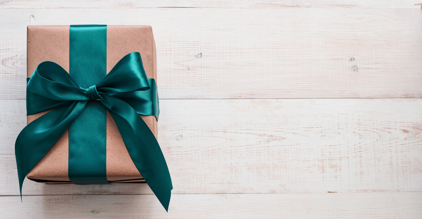 Brown gift box with green ribbon