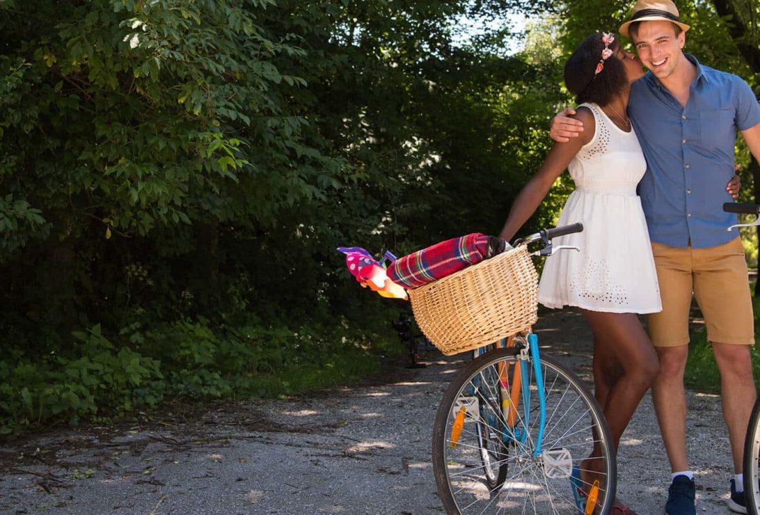 young couple biking in Cedarburg