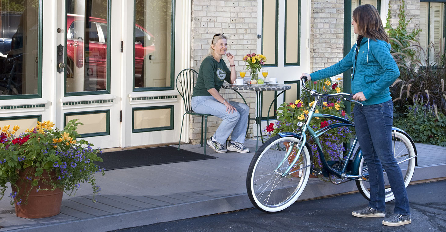 a woman with a bike outside the inn