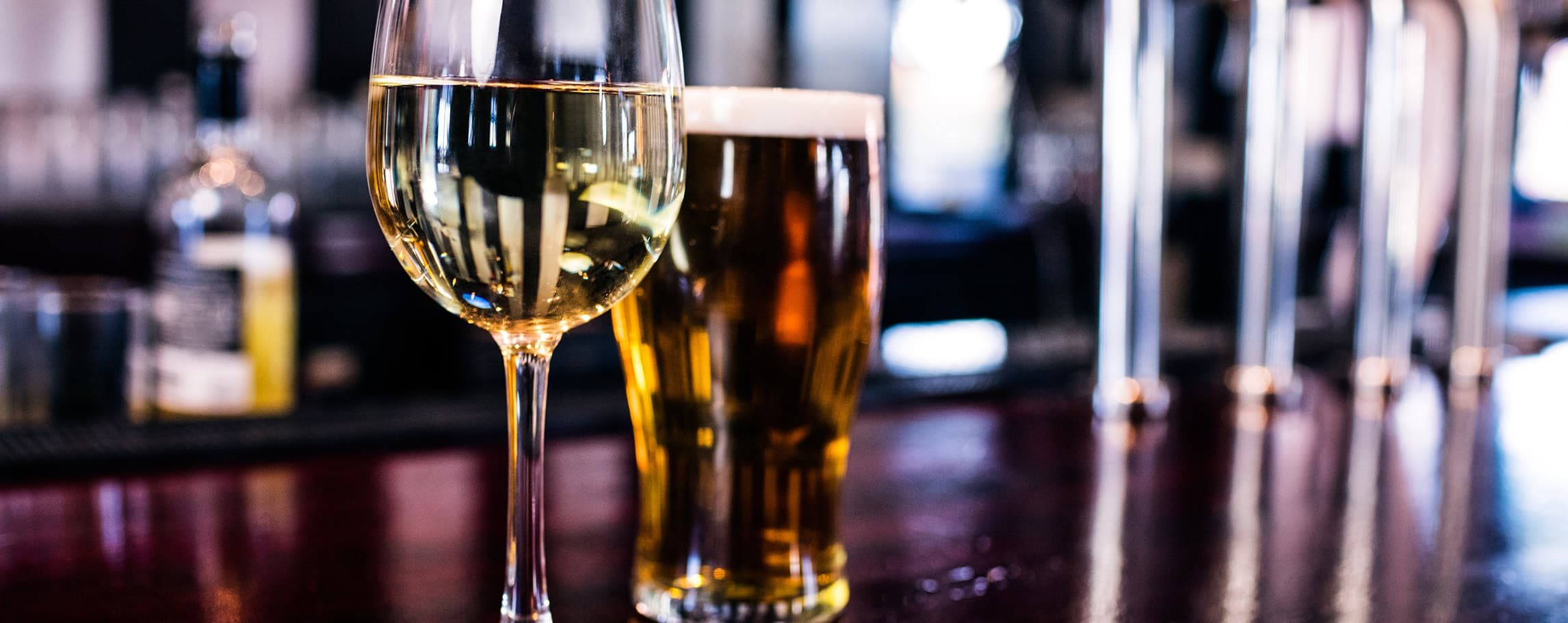 glass of wine and beer at the bar at a restaurant