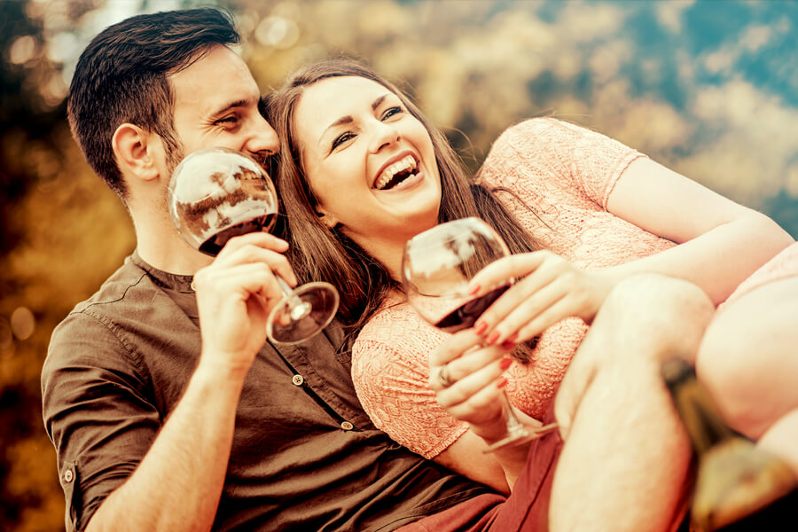 couple smiling with wine glasses at Cedarburg Harvest Festival