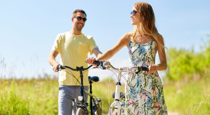 a couple biking together outdoors