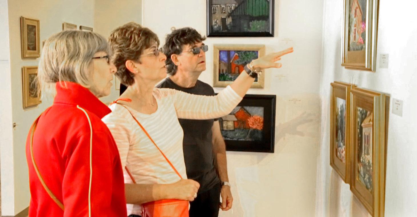 a group of people looking at art in Cedarburg