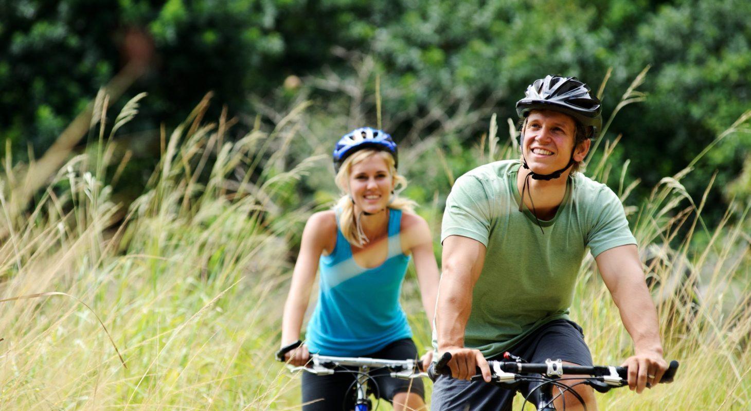 couple riding bikes outdoors in Cedarburg